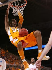 Tennessee's J.P. Prince dunks during the game against