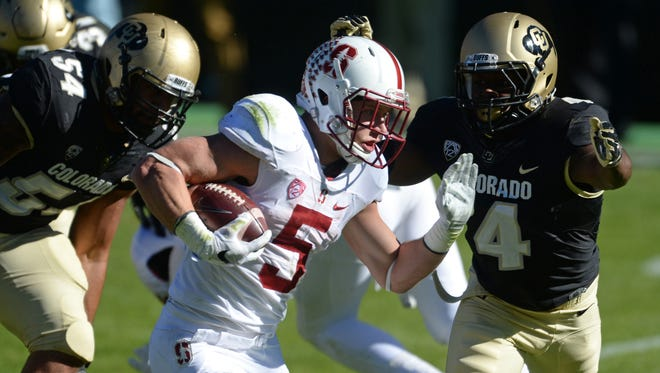 Colorado defensive back Chidobe Awuzie looks to tackle Stanford running back Christian McCaffrey (5) during a 2015 game.
