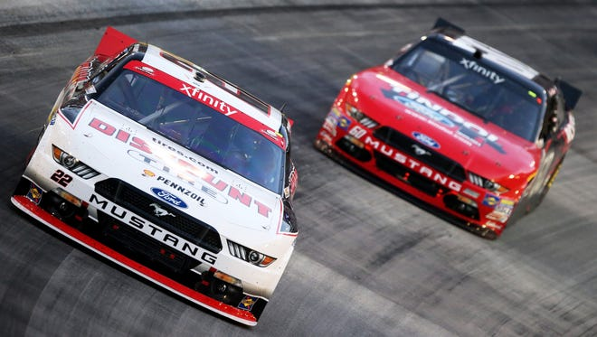 Ryan Blaney leads Chris Buescher during the NASCAR XFINITY Series Food City 300 at Bristol Motor Speedway on August 21, 2015 in Bristol, Tennessee.
