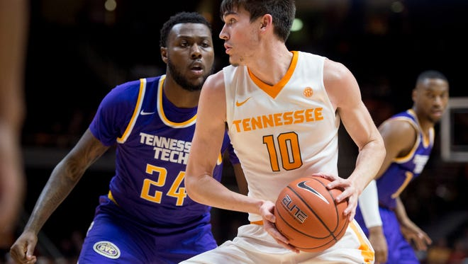 Tennessee's John Fulkerson is defended by Tennessee Tech Ja'Cardo Hawkins at Thompson-Boling Arena on Dec. 13.