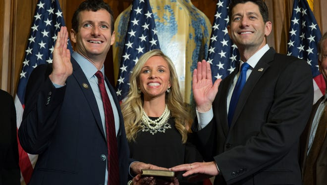 House Speaker Paul Ryan of Wis. administers the House oath of office to Rep. Trey Hollingsworth, R-Ind., during a mock swearing in ceremony on Capitol Hill, Tuesday, Jan. 3, 2017, in Washington.