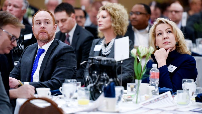 Sioux Falls Chamber of Commerce President Jason Ball (left) and Public Policy Director Debra Owens (right) listen to a speaker during the Good Morning Sioux Falls Legislative Breakfast hosted by the Sioux Falls Area Chamber of Commerce on Thursday, Jan. 4, 2017. Legislators and business leaders rubbed shoulders at the event which aimed to let local lawmakers explains their legislative priorities before the 2018  session.