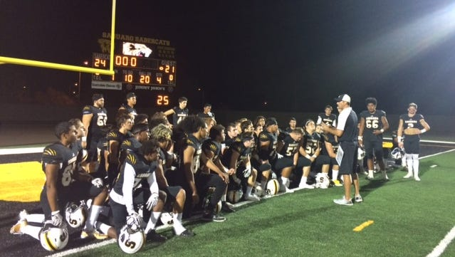 Saguaro gathers in the endzone for a post-game talk with their head coach Jason Mohns.