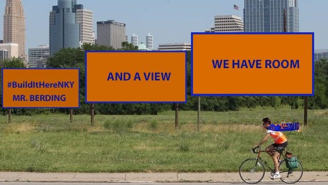 A Northern Kentucky Chamber of Commerce illustration shared on Twitter shows a bicyclist wearing FC Cincinnati soccer club gear rolls by mock billboards advertising a possible Newport stadium site with a view of Downtown Cincinnati.