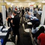 Job seekers gather at the Dutchess County Regional Chamber of Commerce job fair, held at the Poughkeepsie Grand Hotel on Sept. 17, 2014.