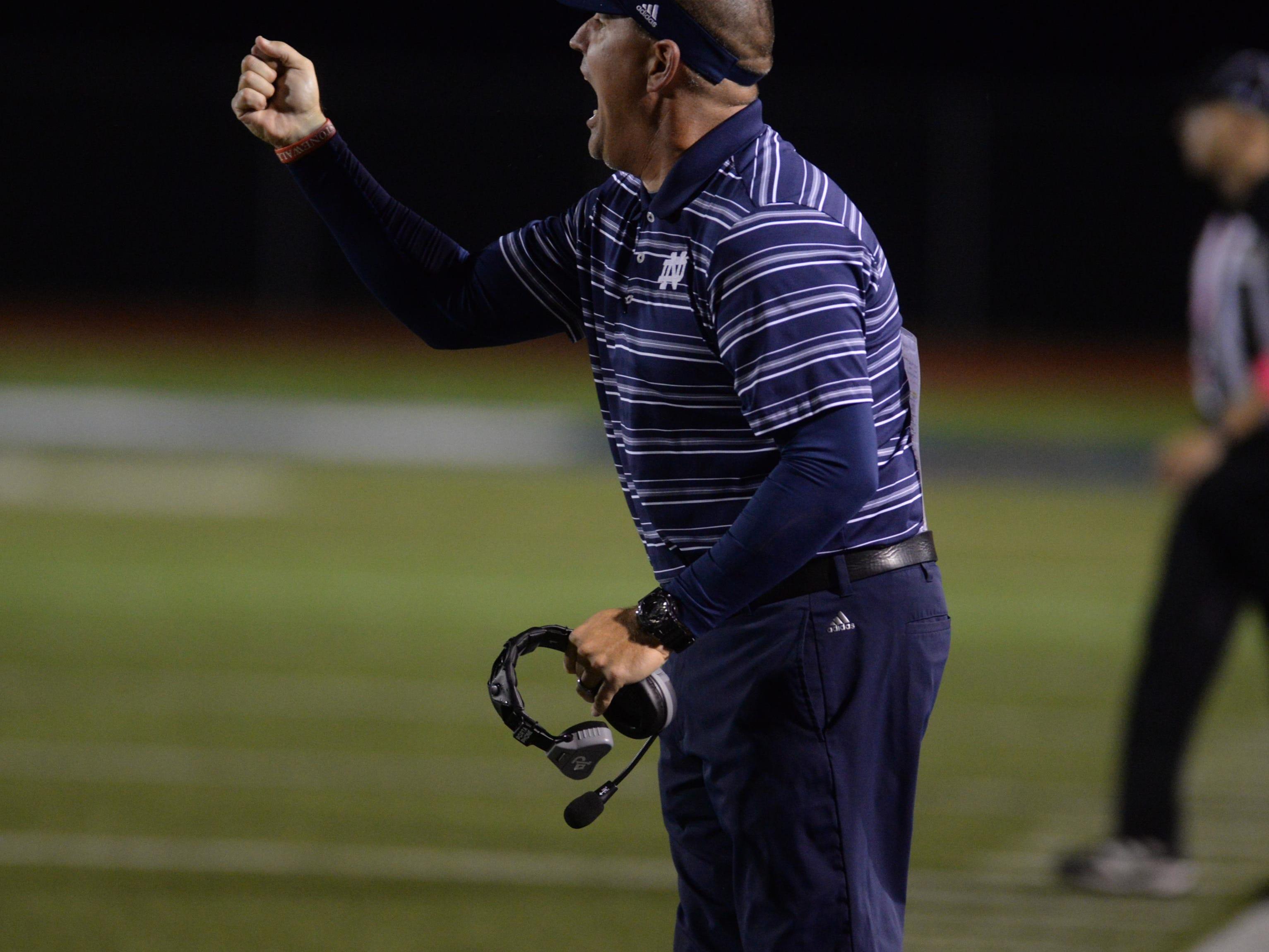 North DeSoto head coach Scott Abernathy yells to his players during their game against Minden.