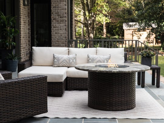 A unique fire pit can boost your outdoor space with a cozy, modern glow.