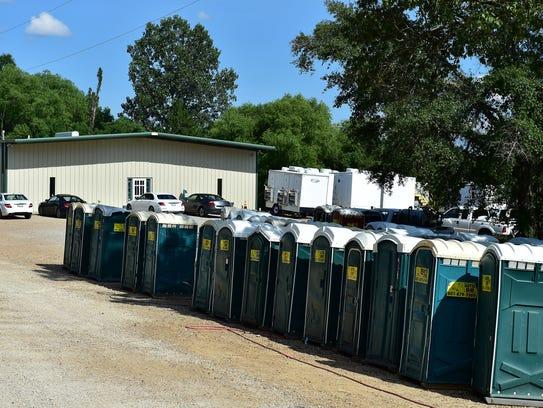Porta-johns line the driveway at Gotta Go Site Service