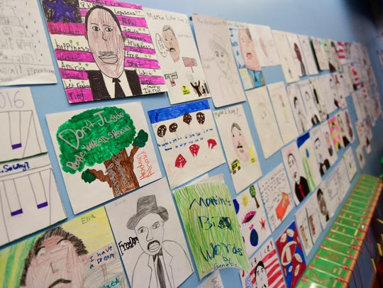 Art contest entries line the walls on Monday, January