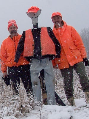 Carl Bonde (from left), Hunting Buddy and Dave Bonde. Hunting Buddy was created to funnel deer so they didn't sneak away in a direction where the men couldn't get a shot.