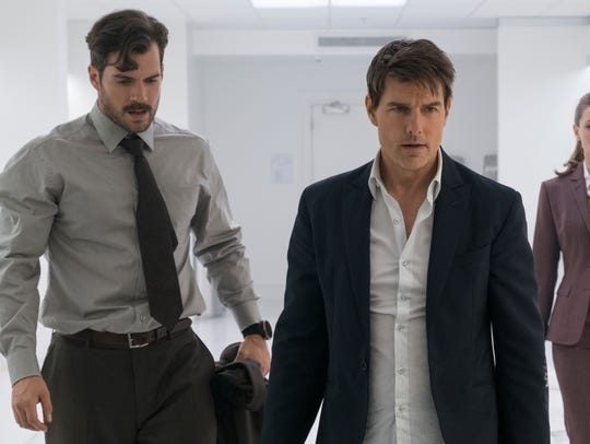 Henry Cavill's Walker (left) and Tom Cruise's Hunt had very different methods in their bathroom brawl.