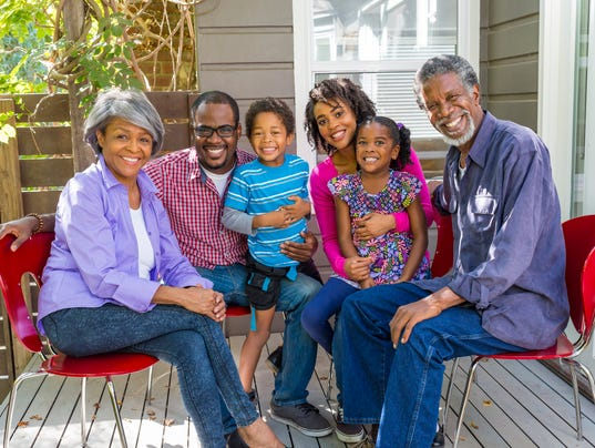 Happy Three Generation African American Family Relaxing at Home