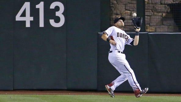 Arizona Diamondbacks' Chris Owings (16) makes a catch