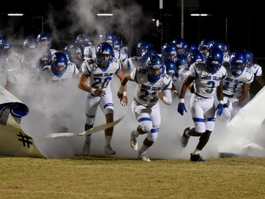 Barron Collier players take the field before the game against Largo in the 2017 Florida High School Football Playoff Brackets: FHSAA - Class 6A tournament in Largo, Florida on Friday, Nov. 10, 2017.