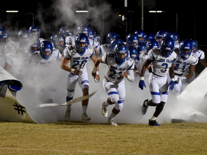 Barron Collier players take the field before the game