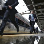 People arriving late run to board their assigned car of the annual New Jersey Chamber of Commerce's 'Walk to Washington' train at the Trenton train station Thursday, Feb. 25, 2016, in Trenton, N.J. The Amtrak train gets its name from the idea that state lawmakers, lobbyists and business leaders walk up and down the train isles, networking, all the way from Newark to the nation's capital in a train chartered by the New Jersey Chamber of Commerce. (AP Photo/Mel Evans)