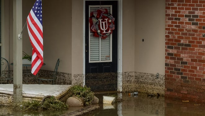 A flood-damaged home in Highland Ridge Subdivision in Youngsville is shown.
