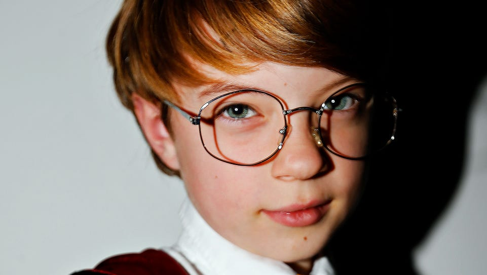 Kevin Giboney, 9, dressed as Harry Potter, poses for