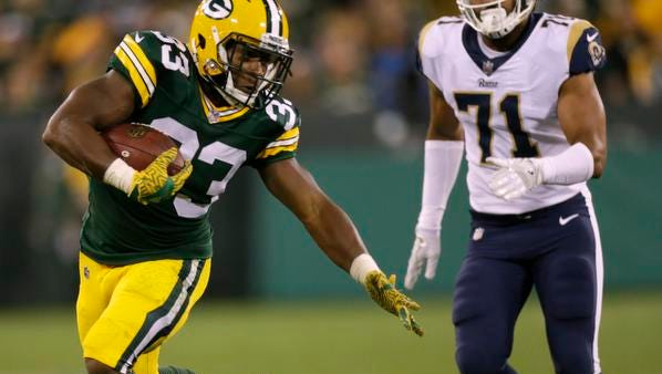 Green Bay Packers running back Aaron Jones (33) evades a tackle by Los Angeles Rams linebacker Nicholas Grigsby (55) during the fourth quarter of their preseason game on Aug. 31, 2017, at Lambeau Field in Green Bay. The Packers travel to play the Rams on Sunday in Los Angeles.
