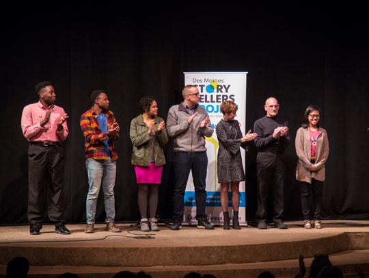 All of the storytellers and coaches, Emmett Phillips, Robert Nishimwe, Christina Fernandez-Morrow, Nate Schultz, Jodi Jinks, Steve Taylor, Linh Ta and Mackenzie Ryan gather at the conclusion of the Des Moines Storytellers Project: New Beginnings event on Dec. 5 at the Des Moines Playhouse.
