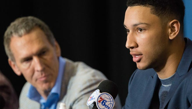 Ben Simmons, the Sixers' No. 1 overall draft pick in June, speaks at an introductory news conference as team president of basketball ops Bryan Colangelo looks on.