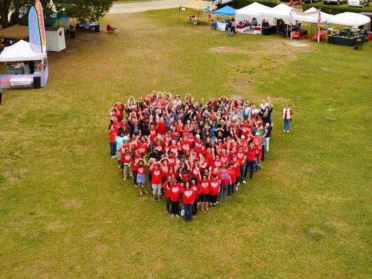 More than 100 people formed the shape of a heart at a Habitat for Humanity event Feb. 14.
