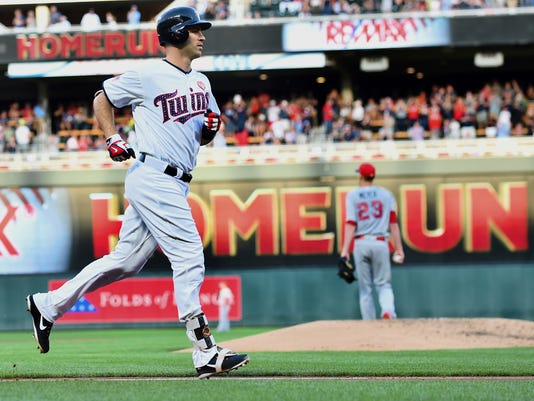 Minnesota Twins first baseman Joe Mauer jogs to home after hitting a three-run home run off Los Angeles Angels starting pitcher Alex Meyer in the second inning of a baseball game, Monday July 3, 2017, in Minneapolis. (AP Photo/John Autey)