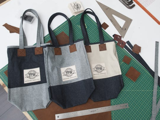 Tote bags from The Factory Workers line of clothing