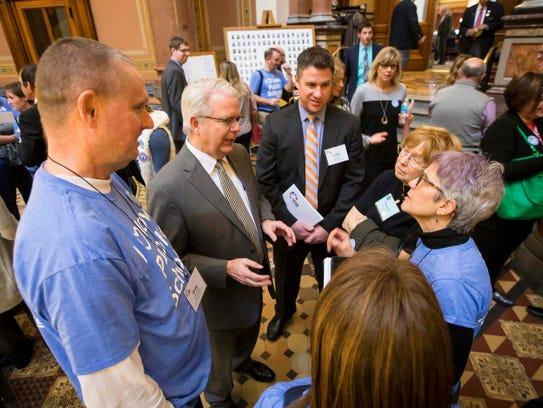 Rep. John Forbes (D) speaks with school board members