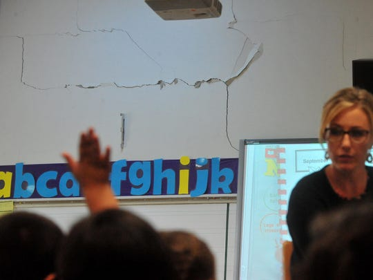 Major cracking in the plaster walls of some of the classrooms at Longfellow Elementary School are just some of the problems the district want to address through a school bond.