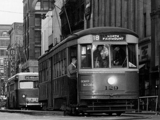 This streetcar photo was taken on April 25, 1951, at 5:55 a.m. at 5th & Vine. In the background is a trolley bus that was taking the place of streetcars.