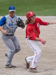 KCC's Joel Leadford tags the Sinclair runner at first base for the final out of the regional title game on Saturday.