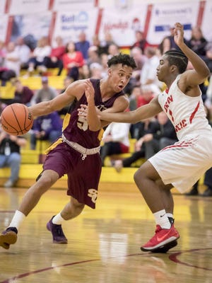 Evan Nelson (5) of Tucson Salpointe Catholic dribbles against Chandler Seton Catholic in the 4A state tournament at Seton Catholic Preparatory High School on Wednesday, February 14, 2018 in Chandler, Arizona.