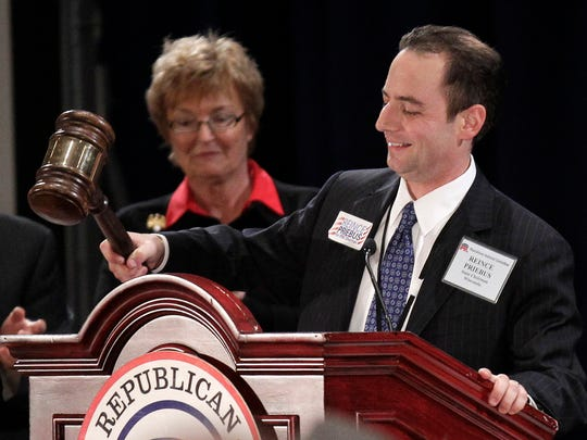 Newly elected Republican National Committee Chairman Reince Priebus bangs the gavel on Jan. 14, 2011, after beating four other candidates in seven rounds of voting.