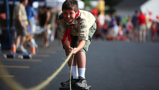 Bret Woodruff, 12, of Greece and a member of the Boy Scout Troop 240 of Greece, plays a game during the 2011 National Night Out Against Crime in 2011.