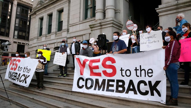 Providence hotel workers rally Thursday evening outside of Providence City Hall in support of an ordinance before the City Council that would require businesses in the hospitality industry to offer jobs to their previous employees before offering them to new people once businesses start to reopen post pandemic.