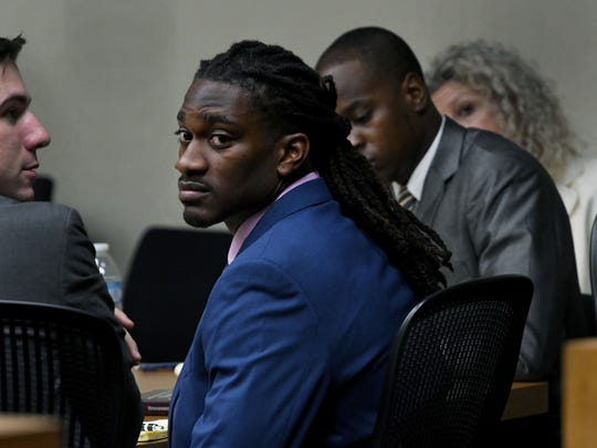 A.J. Johnson and Michael Williams during first day of testimony during their trial Monday, July 23, 2018 where they are accused of raping a female athlete.