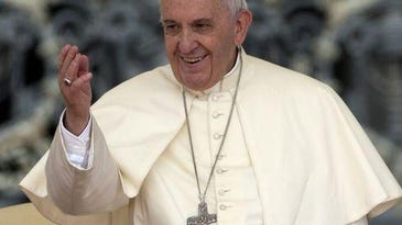 Pope Francis waves to the faithful. Stock