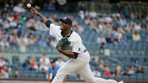 New York Yankees' Michael Pineda delivers a pitch during the first inning of a baseball game against the Los Angeles Angels on Tuesday, June 7, 2016, in New York.