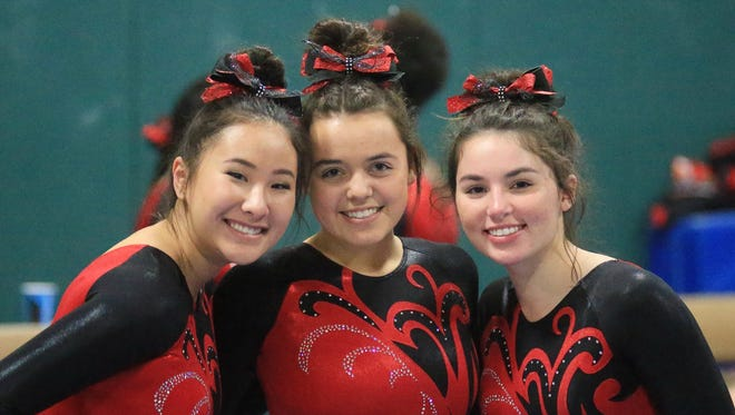 Canton girls gymnastics co-captains (from left) Annika Wang, Rachel Socha and Katherine Najduk are looking forward to another winning season. The Chiefs were state runners-up in 2016-17.