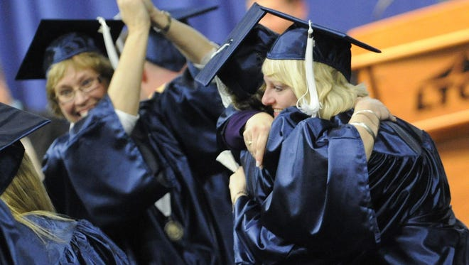 LTC graduates celebrate near the end of the ceremony during the 2010 Lakeshore Technical College graduation.
