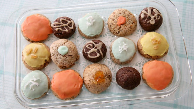 These gussied-up macaroons represent assorted flavors: orange, lemon, lime and mocha.