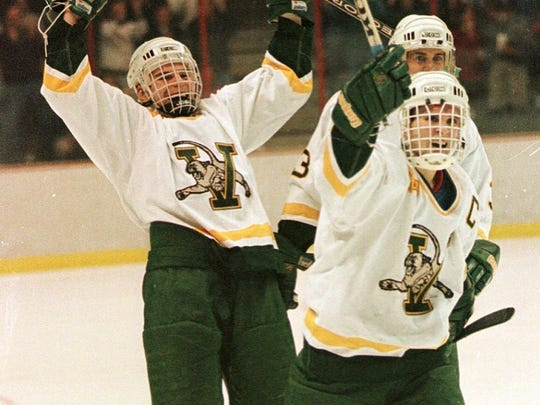 Members of the University of Vermont men's hockey team celebrate their NCAA Division I East Regional win over Lake Superior State in Albany, N.Y. in 1996.