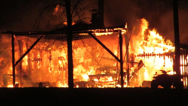 A fire blazes at a sugarhouse on Swanton's Woodshill Road early Friday morning.