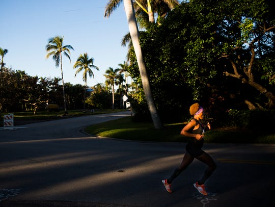Belainesh Gebre runs during the Naples Daily News Half