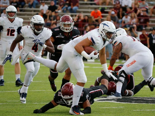 UTEP tight end Josh Weeks is able to maintain his balance after catching a pass and advances it for several yards during action in Miners game against the NMSU Aggies. The Aggies of New Mexico State. The Aggies took a 21-7 lead into the locker room.