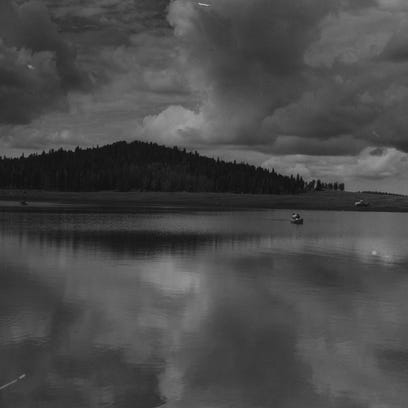 A boat rests on the surface of Big Lake, a popular fishing site in Arizona's White Mountains, in 1955.