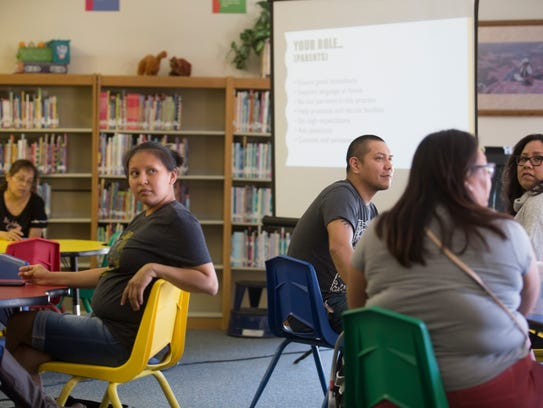 Parents gather information on a Navajo dual language immersion program Monday during a meeting at Apache Elementary School in Farmington.