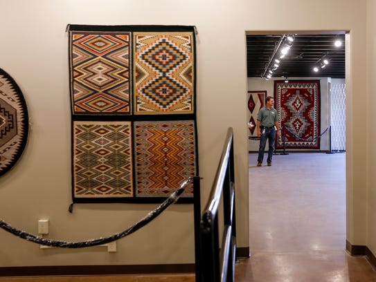 Farmington Museum director Bart Wilsey leads a tour Thursday at the Museum of Navajo Art and Culture in Farmington.