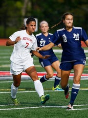 Parsippany's Luisa Barone kicks the ball from Mountain